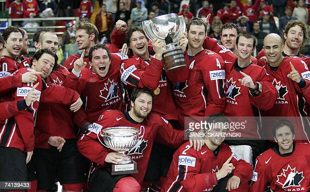 Canadian players pose with a trophy during a reward ceremony of final game of the IIHF International Ice Hockey World Championship in Moscow 13 May...