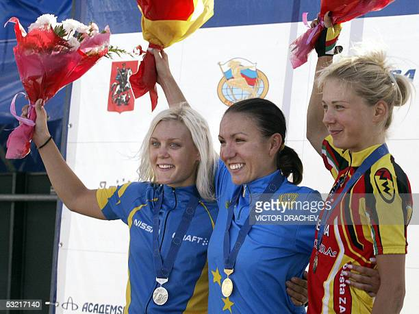 Moscow, RUSSIAN FEDERATION: Medal winners of the U23 122.4 km women time trial celebrate on the podium in Moscow, 09 July 2005 at the European Road...