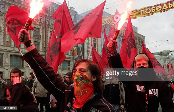 Member of the Avantguard of Red Youth communist movement holds a flare during their rally in central Moscow 09 May 2007 during the annual celebration...