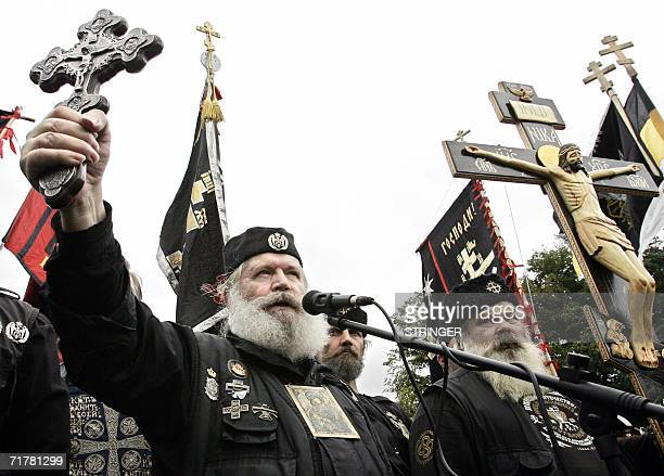 Members of Russian Orthodox citizen union hold up a cross in central Moscow in protest of US pop star Madonna's concert in Russia 04 September 2006...
