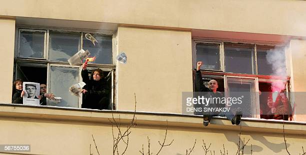 Members of the radical National Bolshevik party shout slogans against Sergei Ivanov Russian Defence Minister and hold a portrait of the private...