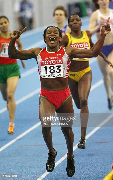 Moscow, RUSSIAN FEDERATION: Mozambique's Maria de Lurdes Mutola celebrates as she wins the women's 800 meters final at the 11th IAAF World Indoor...