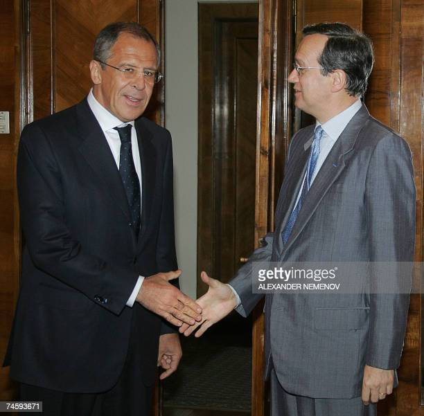 OSCE SecretaryGeneral Marc Perrin de Brichambaut shakes hands with Russian Foreign Minister Sergei Lavrov during their meeting at Russia's Foreign...