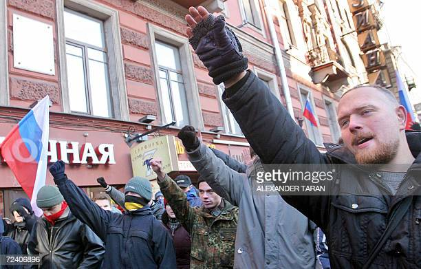 Protestors salute during a rally marking National Unity Day in St Petersburg 04 November 2006 Nationalists began a series of protest rallies across...