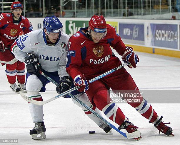 Russian Alexander Ovechkin fights for puck with Italian Armin Helfer during a qualifying round group E game of the IIHF International Ice Hockey...