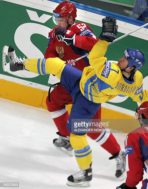Russian Andrey Markov sends Ukrainian Vasyl Bobrovnikov down during the preliminary round group D game of the IIHF Internetional Ice Hockey World...