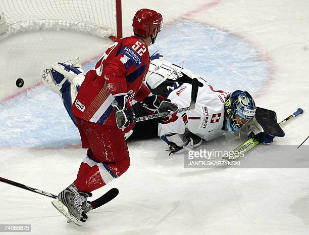 Russian Andrey Markov vies with Swiss goalkeeper Jonas Hiller as Russia scored a goal during a qualifying round group E game of the IIHF...