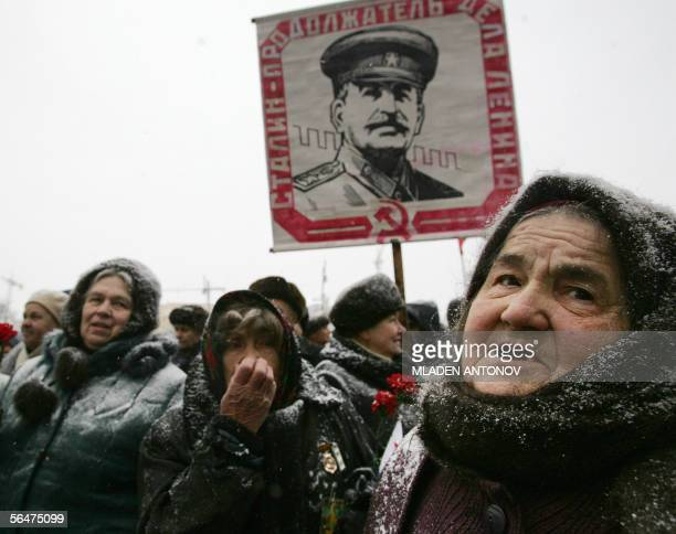 Russian Communist party supporters carrying portraits gather to pay respect to the grave of the Soviet dictator Joseph Stalin marking the Soviet...