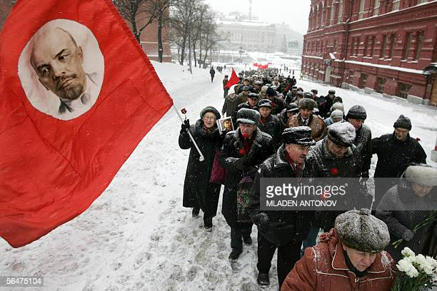 Russian Communist party supporters carrying red flags gather to pay respect to the grave of the Soviet dictator Joseph Stalin marking the Soviet...