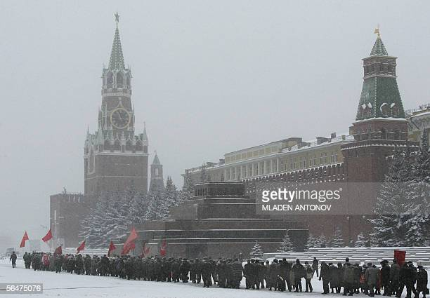 Russian Communist party supporters pay respect at the grave of the Soviet dictator Joseph Stalin on the Red Square outside Kremlin wall in Moscow...