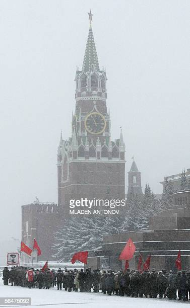 Russian Communist party supporters pay they respect at the grave of the Soviet dictator Joseph Stalin on the Red Square outside the Kremlin wall in...