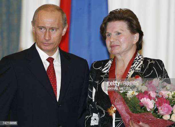 Russian President Vladimir Putin and first woman in space cosmonaut Valentina Tereshkova pose after an awarding ceremony in Moscow's Kremlin 22 May...