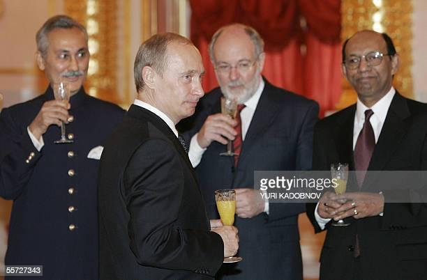Russian President Vladimir Putin toasts with Ambassadors to Moscow Pakistani Mustafa Kamal Kazi Australian Robert James Tyson and Bangladesh Amir...