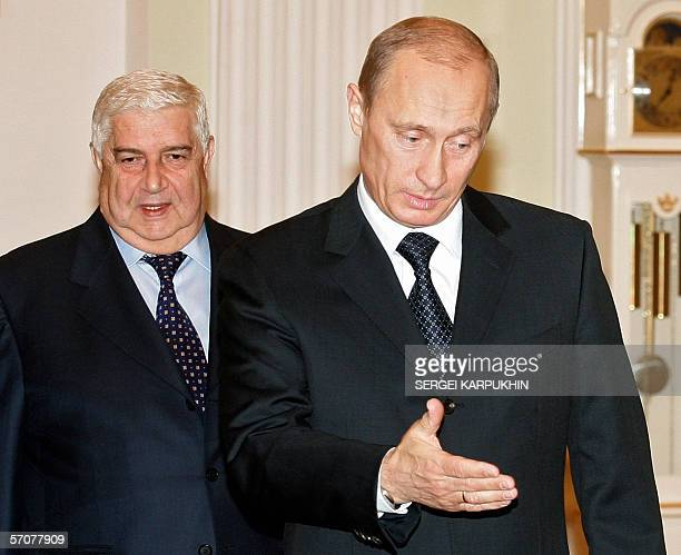 Russian President Vladimir Putin welcomes Syrian Foreign Minister Walid Muallem during their meeting in Moscow's Kremlin 14 March 2006 Syrian Foreign...