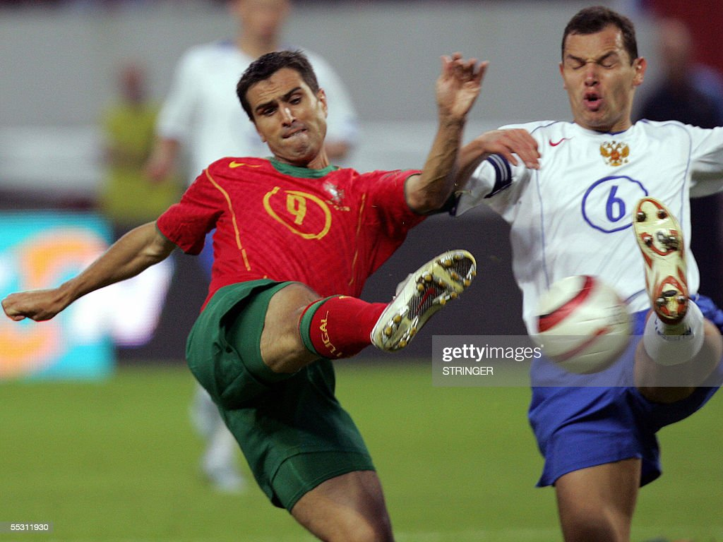 Russia's Yervgeny Aldonin challenges with Portugese Pedro Nesendes