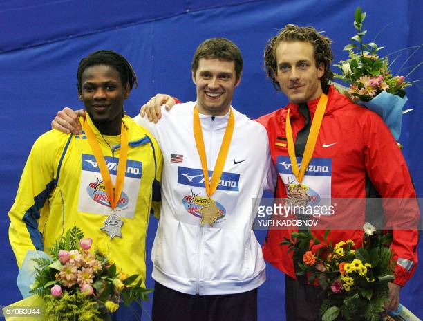 Sweden's Alhaji Jeng USA's Brad Walker and German Tim Lobinger celebrate on the winners' podium of the men's pole vault evenl at the 11th IAAF World...