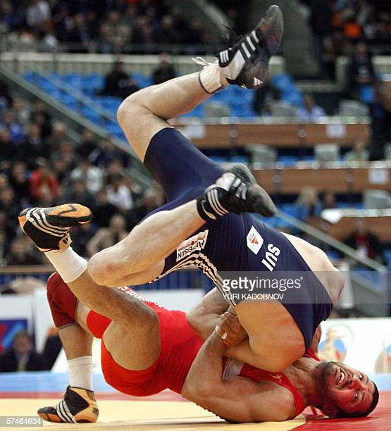 Swiss Reto Bucher wrestles with Mohammad Babulfath of Sweden during the men's grecoroman wrestling 74kg consolation at the European Wrestling...