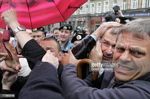 Volker Beck a member of the Bundestag and a German lawyer tries to dodge attacks by Russian nationalists during an unapproved homosexual groups'...