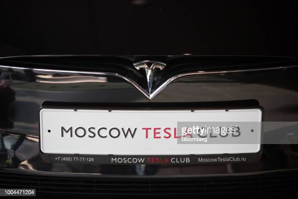 A 'Moscow Tesla Club' branded registration plate sits on the front of a Tesla Inc Model S electric vehicle at the Moscow Tesla Club in Moscow Russia...