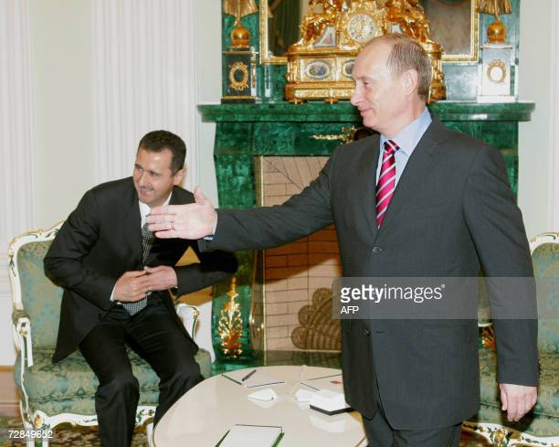 Russian President Vladimir Putin greets the Syrian delegation as Syrian President Bashar alAssad takes a seat as they meet at the Kremlin in Moscow...