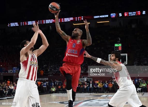 Moscow's Aaron Jackson vies with Olympiacos Piraeus' Kostas Papanikolaou and Georgios Printezis during the Euroleague Final Four semifinal basketball...