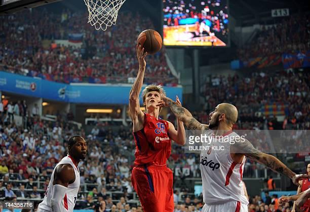 Moscow's Andrei Kirilenko vies with Olympiacos Piraeus' Pero Antic during the Euroleague Final four basketball final match CSKA Moscow vs Olympiakos...