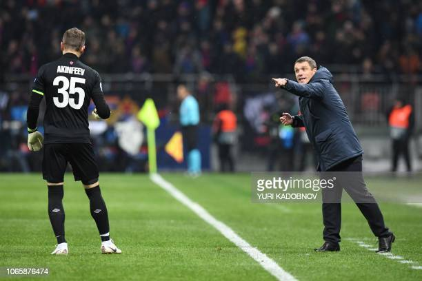 Moscow's Belarus coach Viktor Goncharenko addresses CSKA Moscow's Russian goalkeeper Igor Akinfeev during the UEFA Champions League group G football...