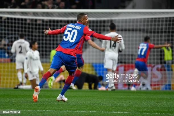 Moscow's Brazilian defender Rodrigo celebrates the opening goal scored by CSKA Moscow's Croatian midfielder Nikola Vlasic during the UEFA Champions...