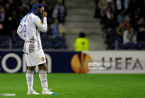 Moscow's Brazilian forward Vagner Love reacts after FC Porto´s midfielder Colombia Fredy Guarin scored during their UEFA Europa League round of 16...