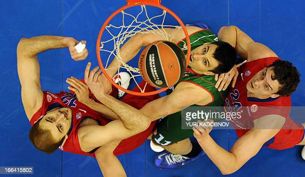 Moscow's center Nenad Krstic and forward Andrey Vorontsevich vies with Caja Laboral's forward Nemanja Bjelica during their Euroleague play off second...