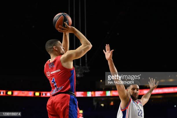 Moscow's Danish guard Iffe Lundberg takes a shot next to Anadolu Efes Istanbul's Serbian guard Vasilije Micic during the Basketball Euroleague Final...