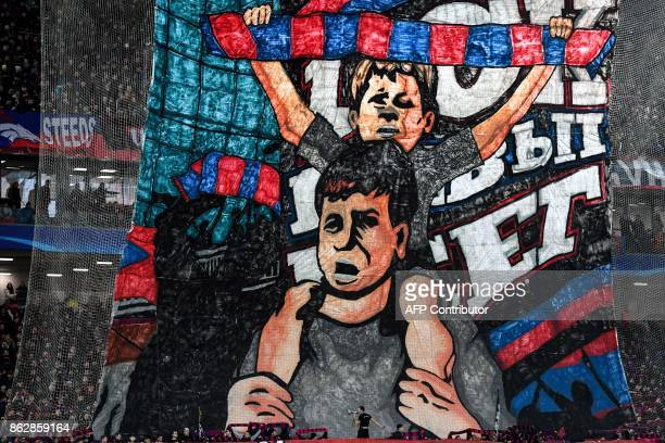 Moscow's fans support their team during the UEFA Champions League Group A football match between PFC CSKA Moscow and FC Basel 1893 at the VEB Arena...