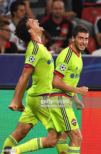 Moscow's Finnish midfielder Roman Eremenko celebrates scoring his team's second goal with his team-mates during the Champions League group E...