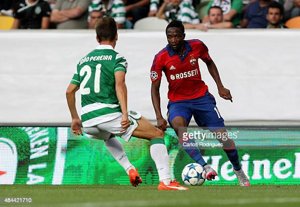 Moscow's forward Ahmed Musa vies with Sporting's defender Joao Pereira during the UEFA Champions League qualifying round playoff first leg match...
