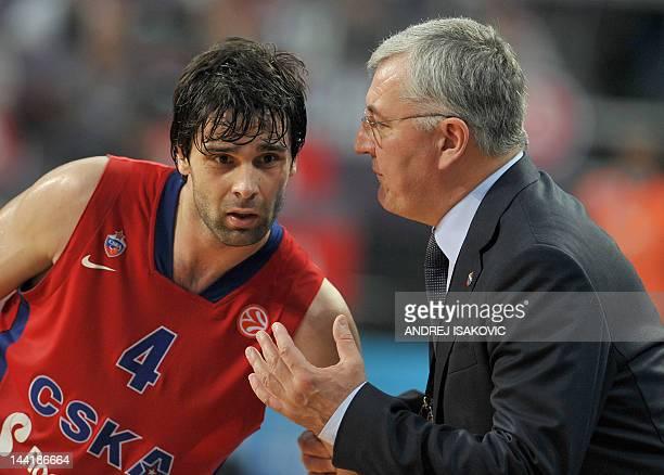 Moscow's Head Coach Jonas Kazlauskas talks to his player Milos Teodosic during the Euroleague Final four basketball semi-final match CSKA Moscow vs...