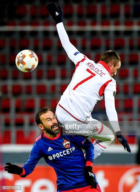 Moscow's Israeli midfielder Bibras Natcho vies with Crvena Zvezda Beograd's midfielder from Serbia Nenad Krsticic during the Europa League Round of...
