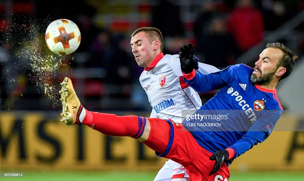 Moscow's Israeli midfielder Bibras Natcho (R) vies with Crvena Zvezda Beograd's midfielder from Serbia Nenad Krsticic during the Europa League Round of 32 second leg football match between CSKA Moscow and Crvena Zvezda Beograde in Moscow on February 21, 2018. / AFP PHOTO / Yuri KADOBNOV