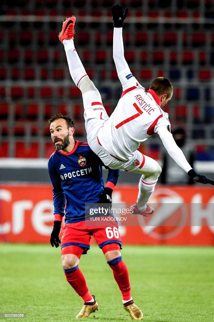 Moscow's Israeli midfielder Bibras Natcho (L) vies with Crvena Zvezda Beograd's midfielder from Serbia Nenad Krsticic during the Europa League Round of 32 second leg football match between CSKA Moscow and Crvena Zvezda Beograde in Moscow on February 21, 2018. / AFP PHOTO / Yuri KADOBNOV
