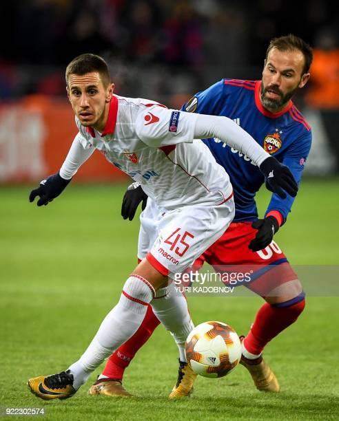 Moscow's Israeli midfielder Bibras Natcho vies with Red Star Belgrade's Serbian forward Aleksandar Pesic during the UEFA Europa League round of 32...