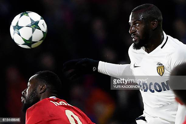 Moscow's Ivorian forward Lacina Traore and Monaco's French midfielder Tiemoue Bakayoko vie for the ball during the UEFA Champions League football...