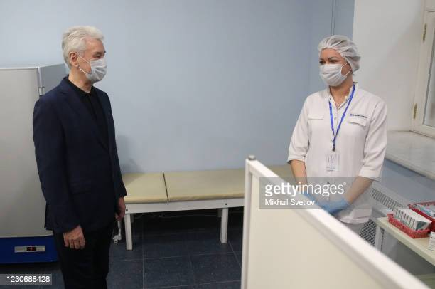 Moscow's Mayor Sergei Sobyanin talks to a nurse at the vaccination room, at the Helikon Opera on January 20, 2020 in Moscow, Russia. Moscow's...