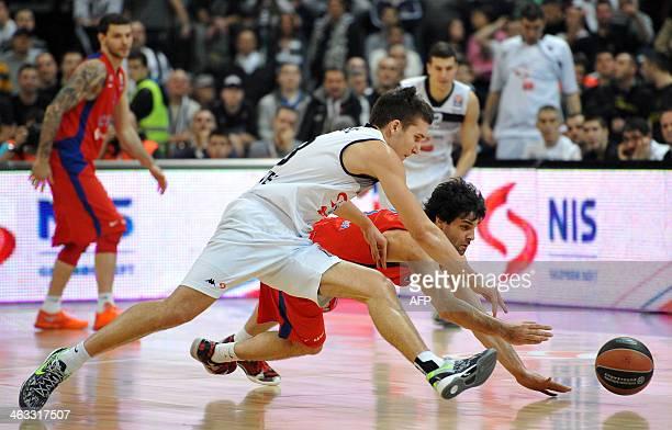 Moscow's Milos Teodosic vies with Partizan's Bogdan Bogdanovic during the Euroleague Top 16 match between Partizan Belgrade and CSKA Moscow at...