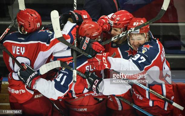 Moscow's players celebrate their victory over SKA St Petersburg during the Western Conference final series of Gagarin Cup 2019 of the Russian...