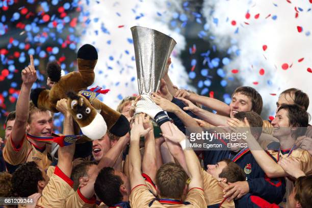 Moscow's players get their hands on the UEFA Cup trophy.