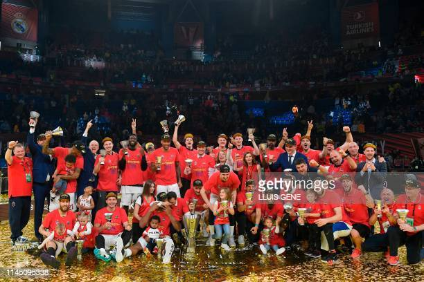 Moscow's players pose wit the trophy after winning the EuroLeague final basketball against Anadolu Efes at the Fernando Buesa Arena in Vitoria on May...