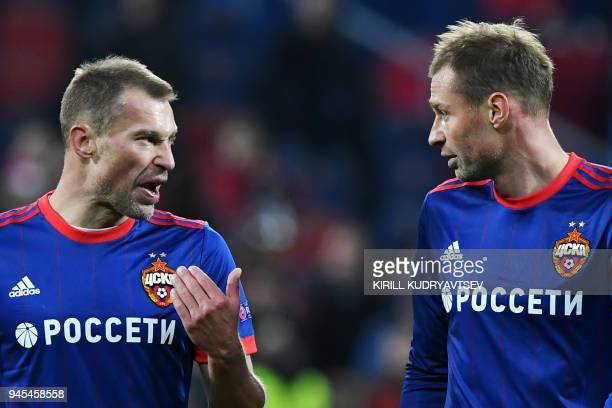 Moscow's Russian defender Aleksei Berezutski and CSKA Moscow's Russian defender Vasili Berezutski react after the UEFA Europa League second leg...