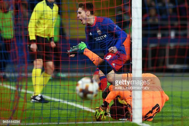 Moscow's Russian defender Kirill Nababkin celebrates scoring during the UEFA Europa League second leg quarterfinal football match between CSKA Moscow...