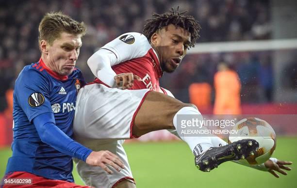 Moscow's Russian defender Kirill Nababkin vies with Arsenal's Nigerian striker Alex Iwobi during the UEFA Europa League second leg quarterfinal...