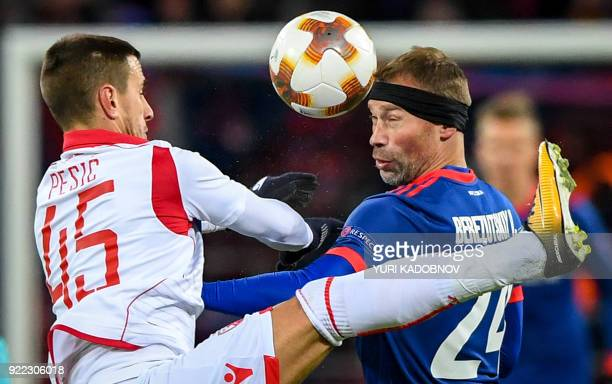 Moscow's Russian defender Vasili Berezutski vies with Red Star Belgrade's Serbian forward Aleksandar Pesic during the UEFA Europa League round of 32...
