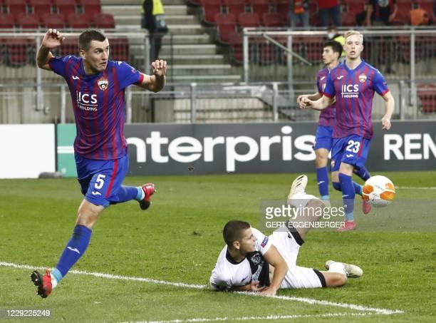 Moscow's Russian defender Viktor Vasin and Wolfsberg's Serbian forward Dejan Joveljic vie for the ball during the UEFA Europa League Group K football...